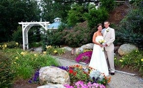beautiful bride and groom posing for wedding photo in the great Smoky Mountains