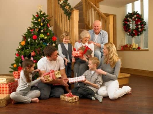 Family exchanging gifts for Christmas