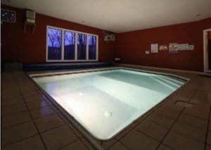 indoor pool in poolin' paradise cabin